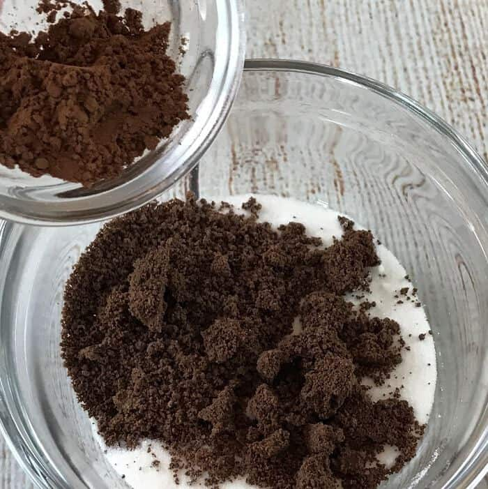homemade chocolate lip scrub recipe with essential oils -- divine combination of chocolate & orange that's both hydrating and gently exfoliating, leaving you with soft, smooth, healthy lips