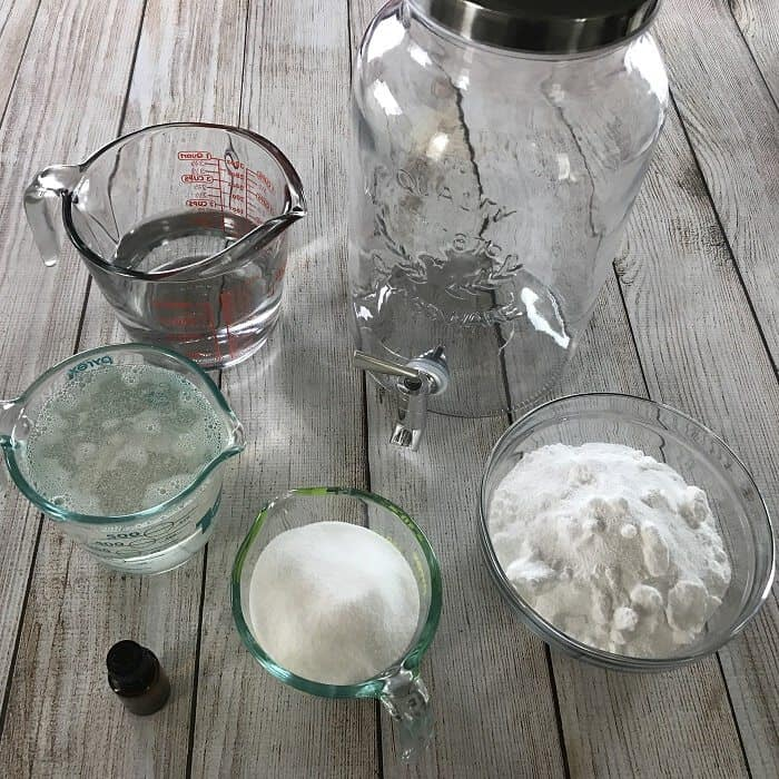 homemade HE liquid laundry detergent recipe with essential oils. natural, non-toxic, & it really works! Removes odors, cleans clothes, rinses clean. #essentialoils #essentialoilrecipes #essentialoilcleaning #naturalDIY #naturalcleaning #essentialoilDIY #laundry #DIYcleaning #homemadecleaners