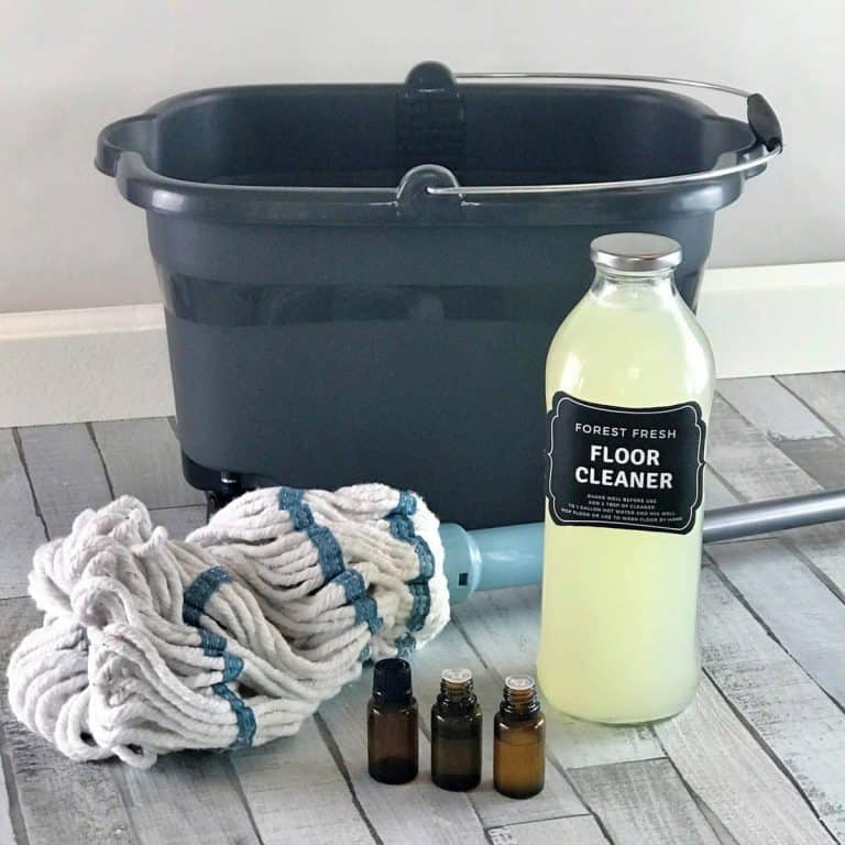 homemade floor cleaner for all your floors - hardwood, laminate, tile, linoleum, and vinyl. 3 ingredient recipe for spotless, streak-free, sparkly, shiny floors. No vinegar, no rinse, non-toxic. {essential oil cleaner, DIY cleaner, essential oil recipes, hardwood floor cleaner, essential oil floor cleaner, tile floor cleaner, laminate floor cleaner)