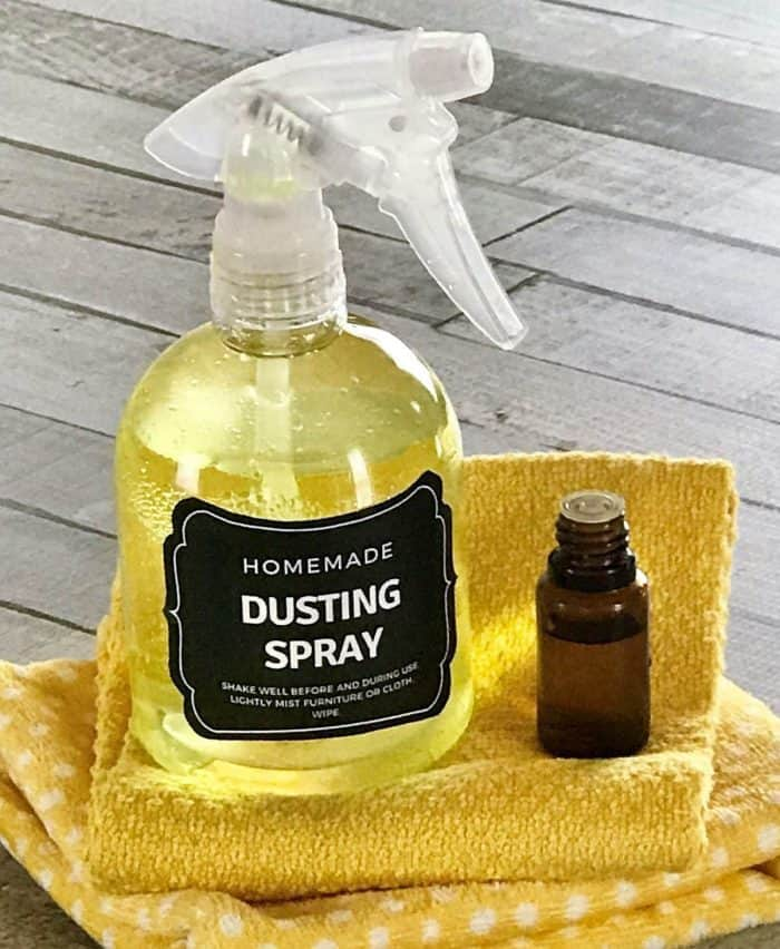 DIY dusting spray with essential oils- cleans and repels dust so you clean less often. Plus it moisturizes, nourishes, and protect wood. It's like a combined dusting spray and wood polish. {free printable label, essential oil recipe, essential oil cleaning, homemade dusting spray, essential oil spray}, natural cleaning} #essentialoilrecipes #DIYessentialoil #naturalcleaning