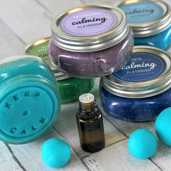 This is the absolute best homemade aromatherapy playdough to help ease stress and anxiety. Easy to customize and make your perfect scent with info about 20+ calming essential oils and 15+ soothing aromatherapy recipes. Super easy to make, uses common ingredients you probably have in your kitchen, in vibrant colors that won't stain your skin, and stays soft & pliable for months. essential oil recipe, DIY playdough, calming playdough, DIY essential oil, doTERRA, Young Living